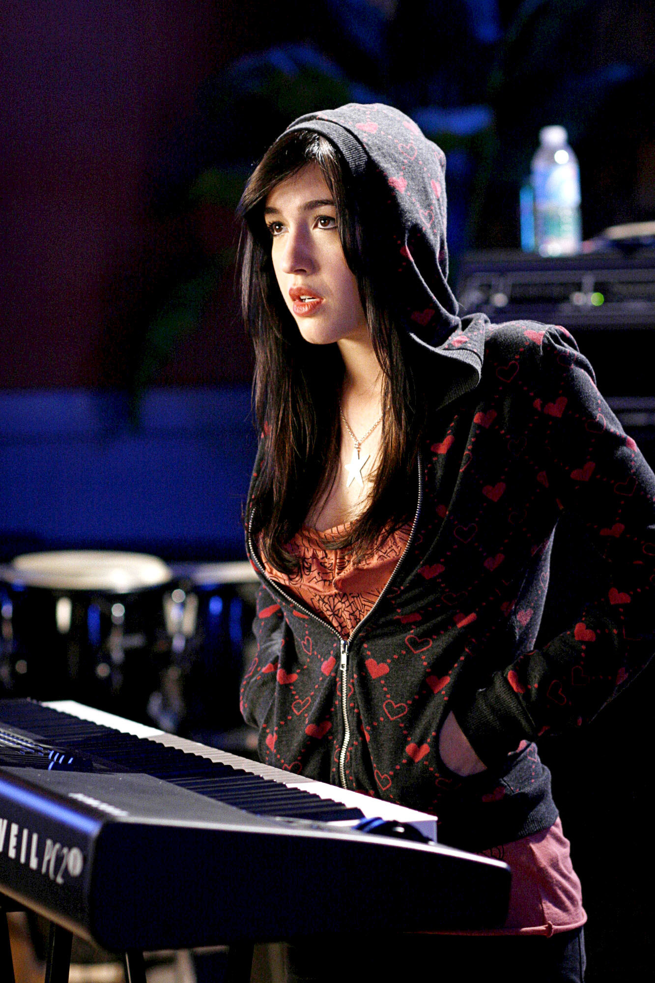 Kate Voegele as Mia in front of the piano