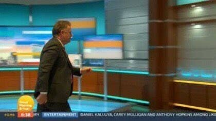 Piers Morgan waking off the set of his TV show