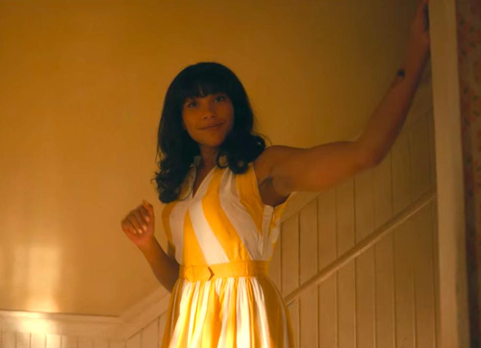 Allison wearing a midi dress