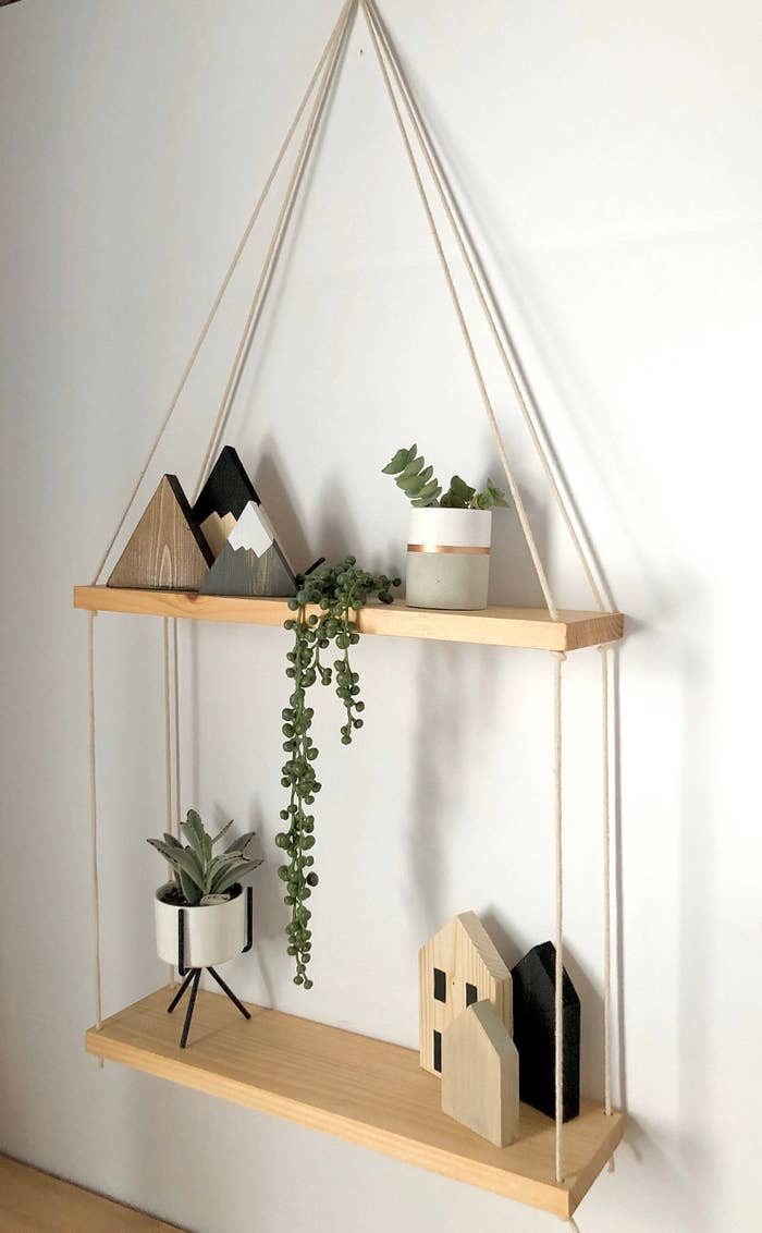 Two-tiered hanging shelf hanging on wall