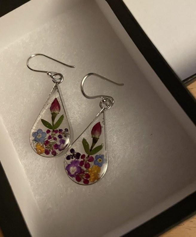 tear drop earrings with flowers inside of them