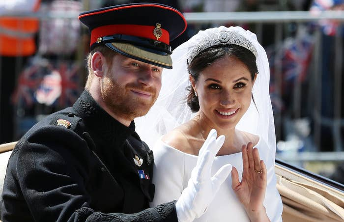 Meghan and Harry wave to onlookers on their wedding day