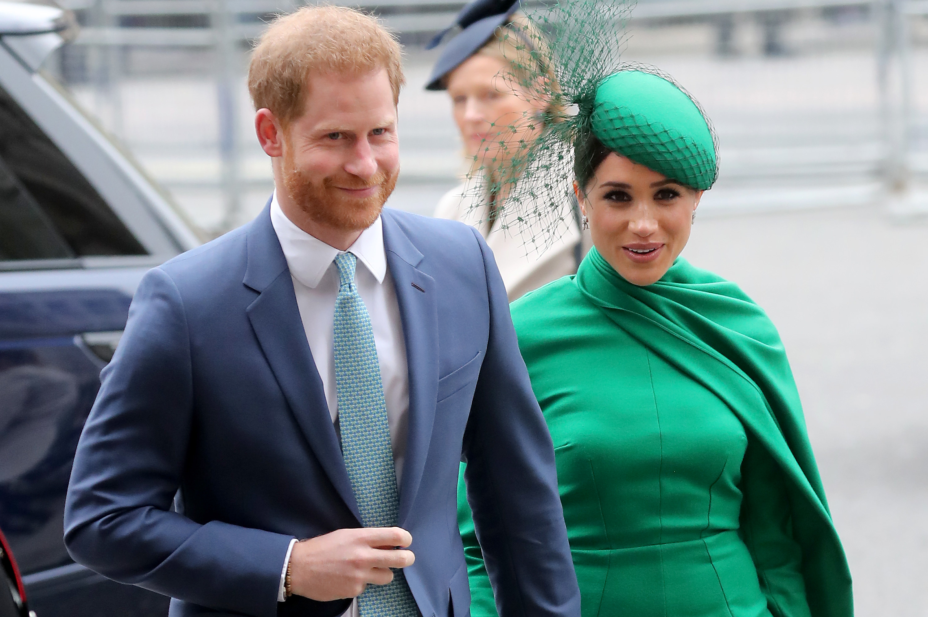 Meghan wears a formal green outfit while heading to an event with Harry