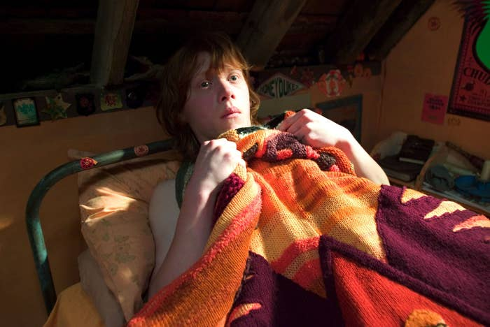 Rupert Grint lays in bed clutching his sheets in Harry Potter and the Goblet of Fire
