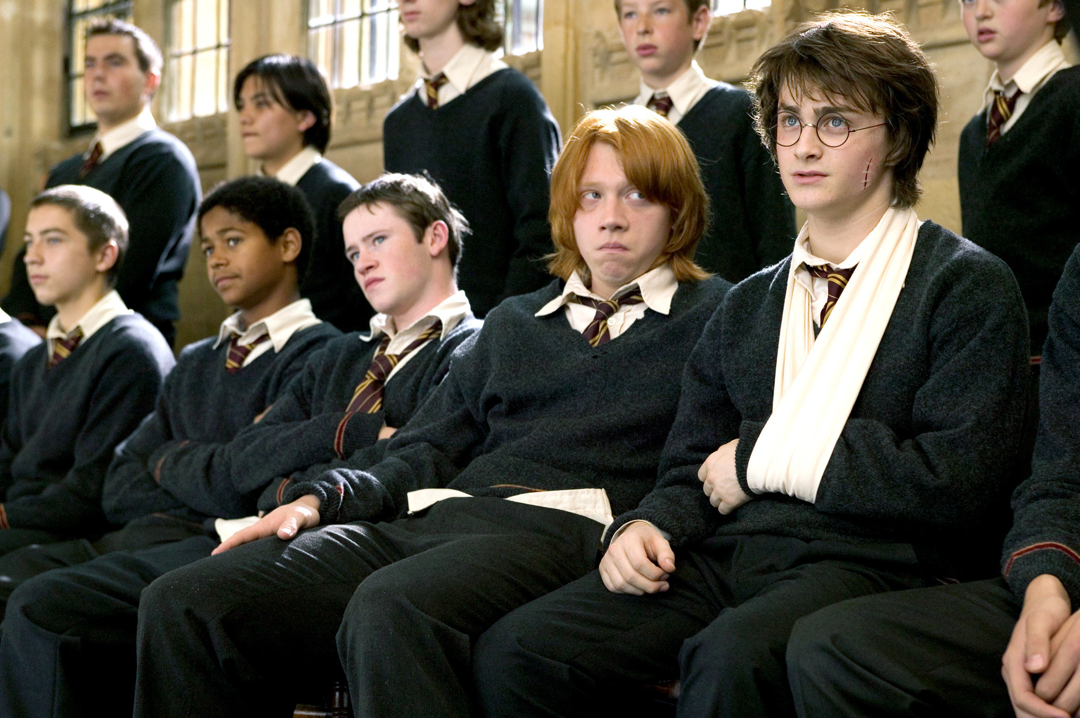 Rupert Grint sits next to Daniel Radcliffe in Harry Potter and the Goblet of Fire