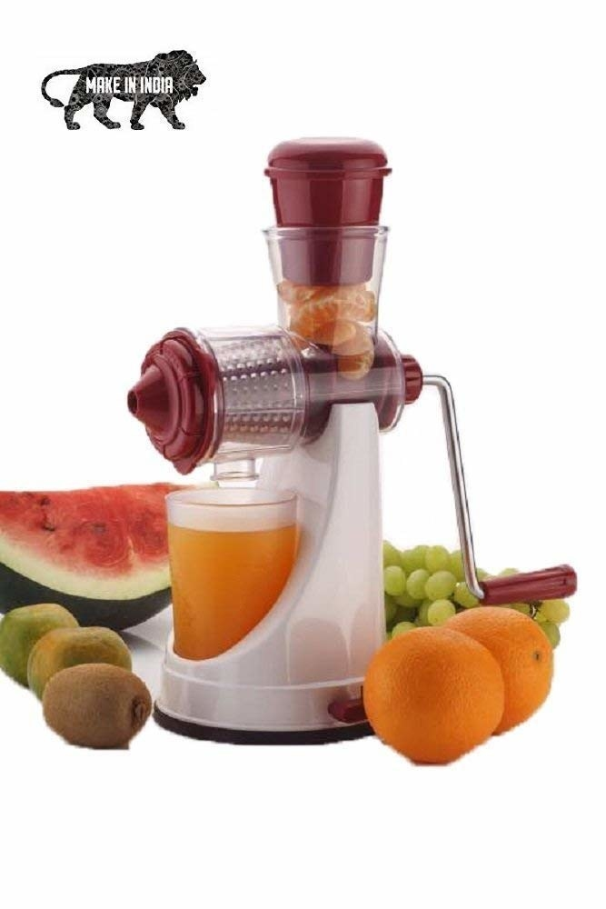 A juicer with fruits next to it
