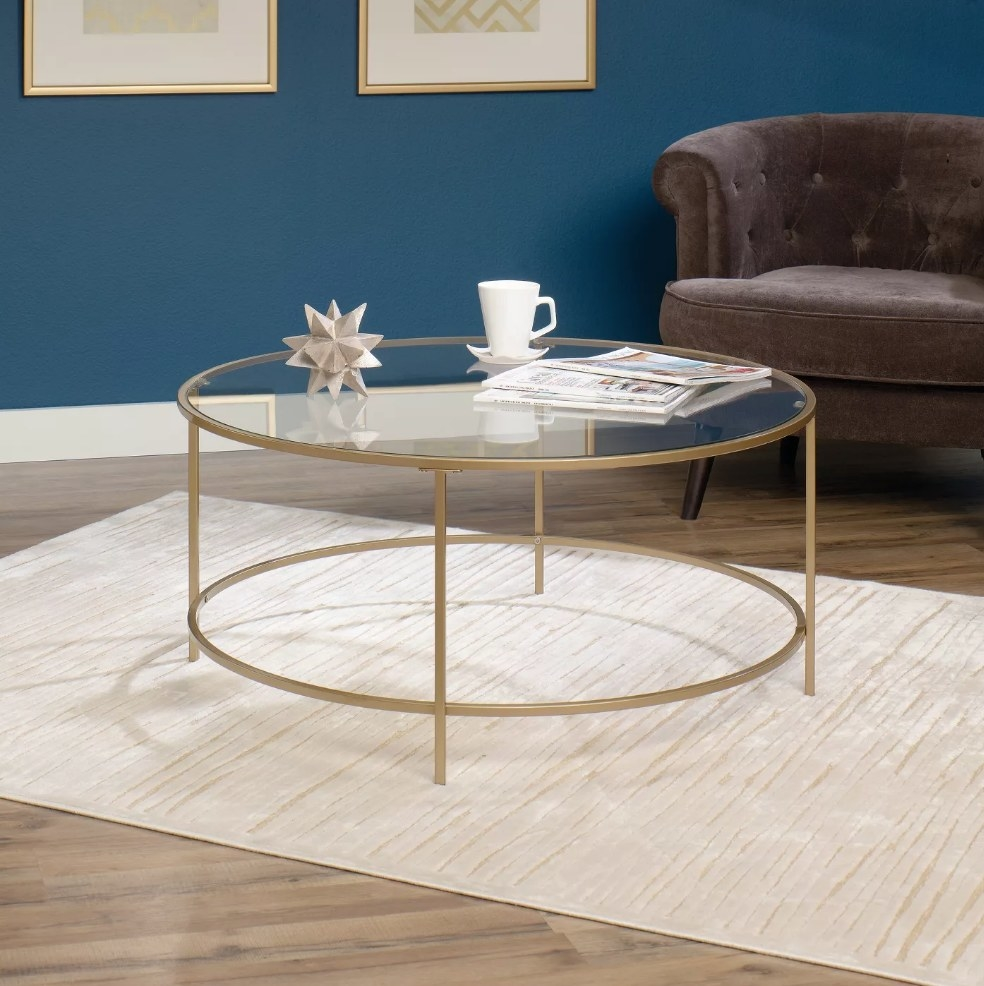 Glass coffee table with gold base