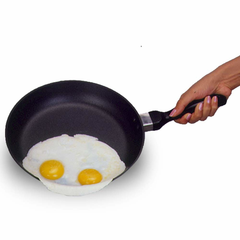 A non-stick frying pan with eggs on it