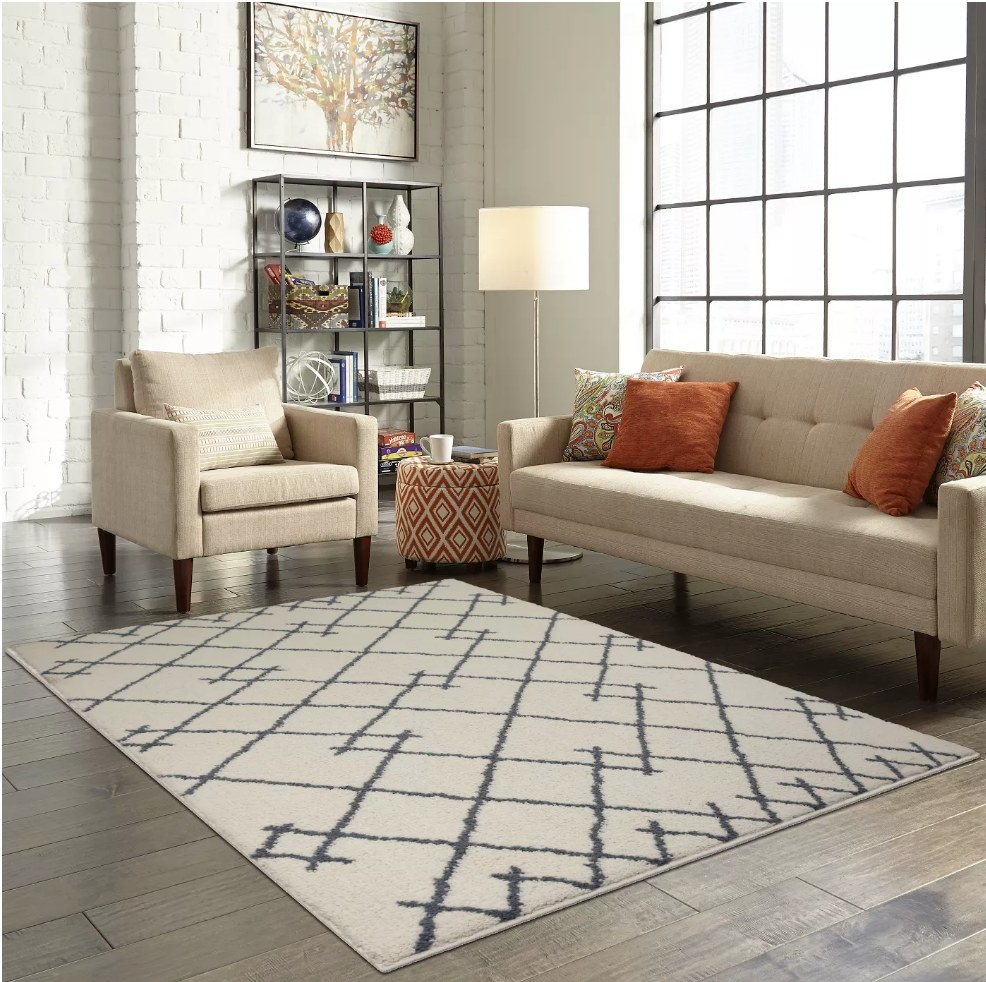 Cream colored area rug with gray pattern