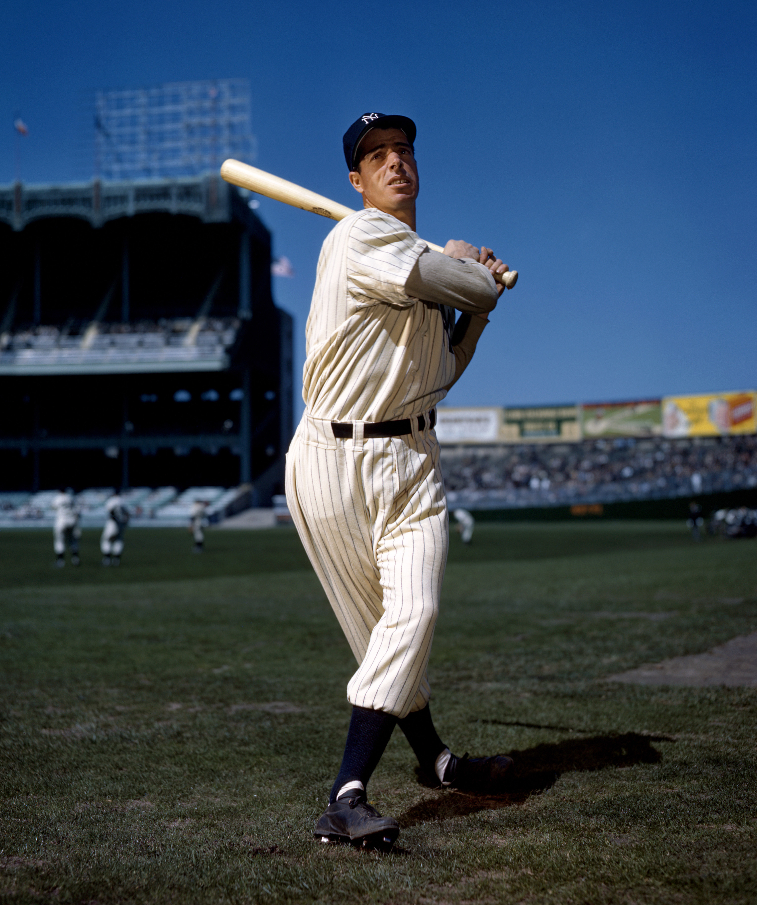 Joe Dimaggio taking a practice swing for the camera