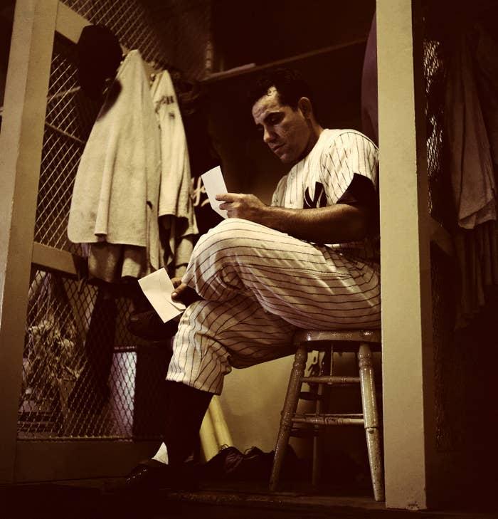 Yogi Berra reading letter in Yankees' locker room