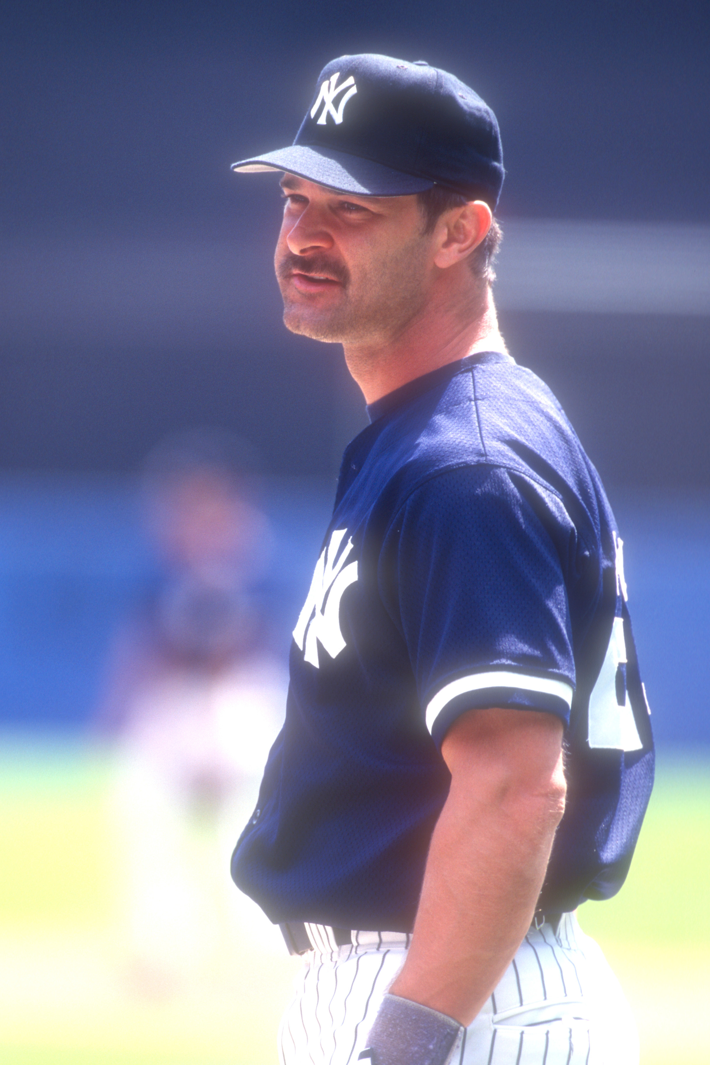 Don Mattingly with a mustache and wearing a Yankees uniform
