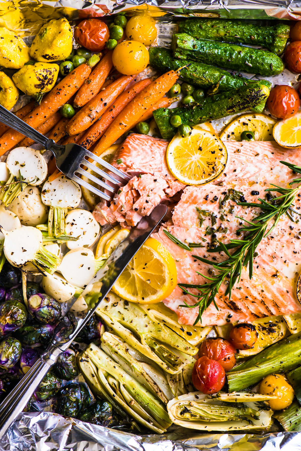 Sheet pan salmon with lots of colorful vegetables.