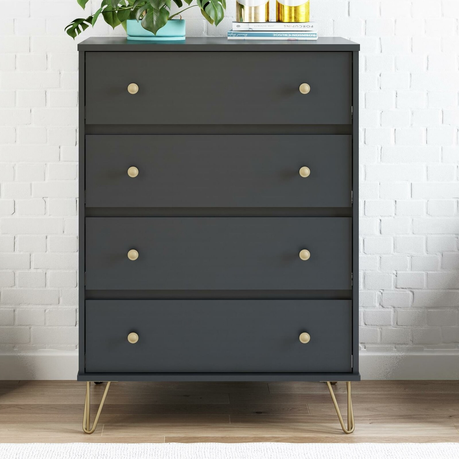 Black particle board dresser with gold legs and hardware