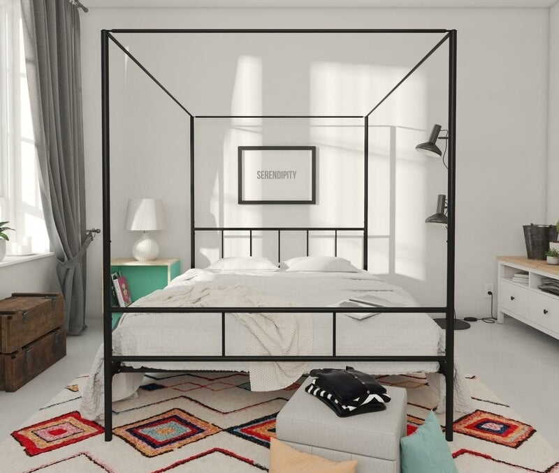 Black metal canopy bed with headboard and footboard