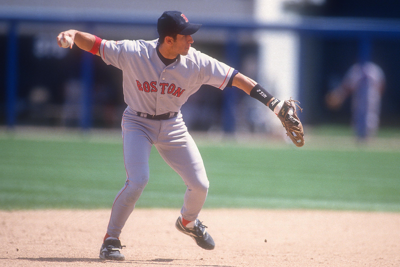 Nomar Garciaparra throwing baseball to first base