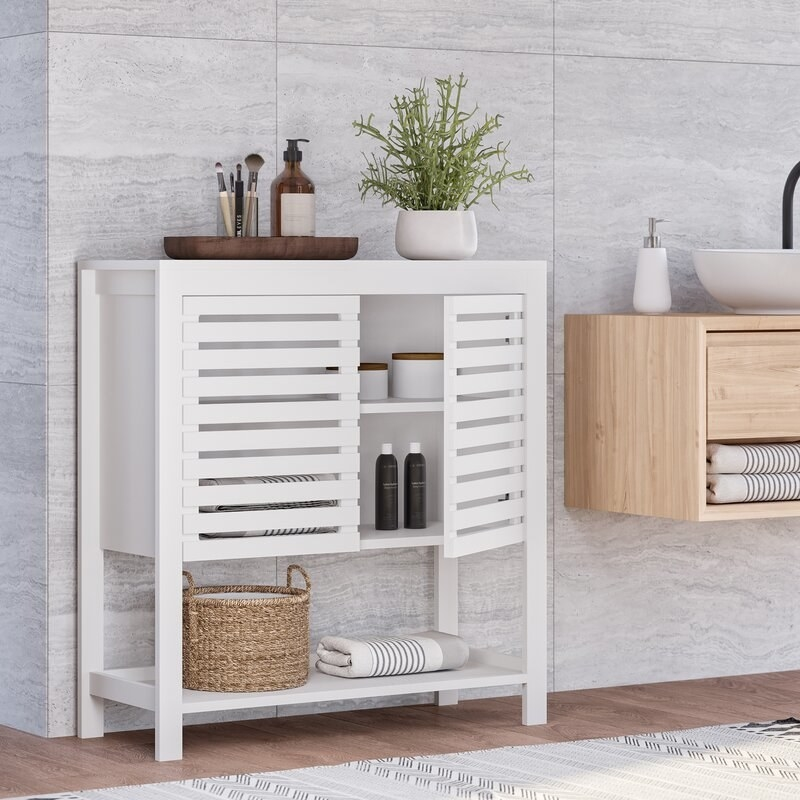 Small white cabinet with two doors and open shelf