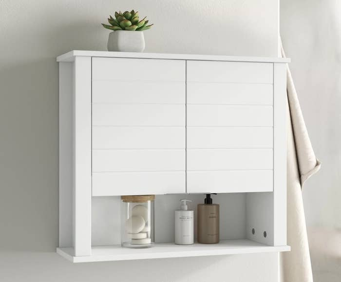 White wall-mounted wall shelf with two doors and open shelf