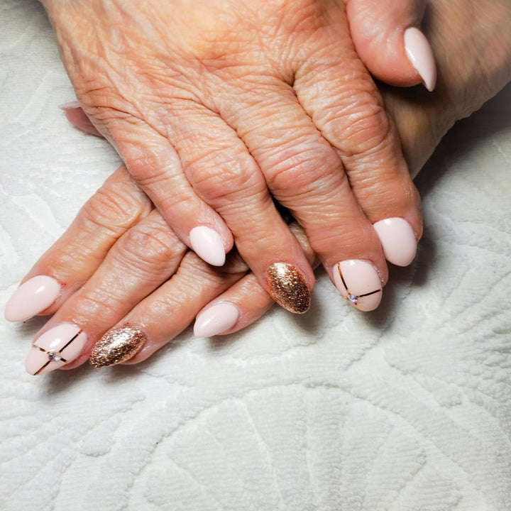 a reviewer's nails with gold accents from the kit