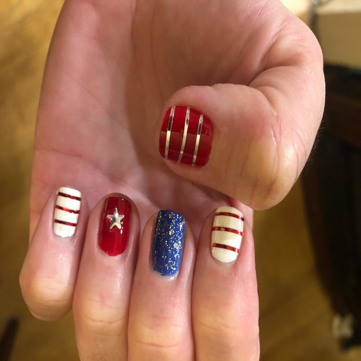 a reviewer's nails done to look like wonder woman