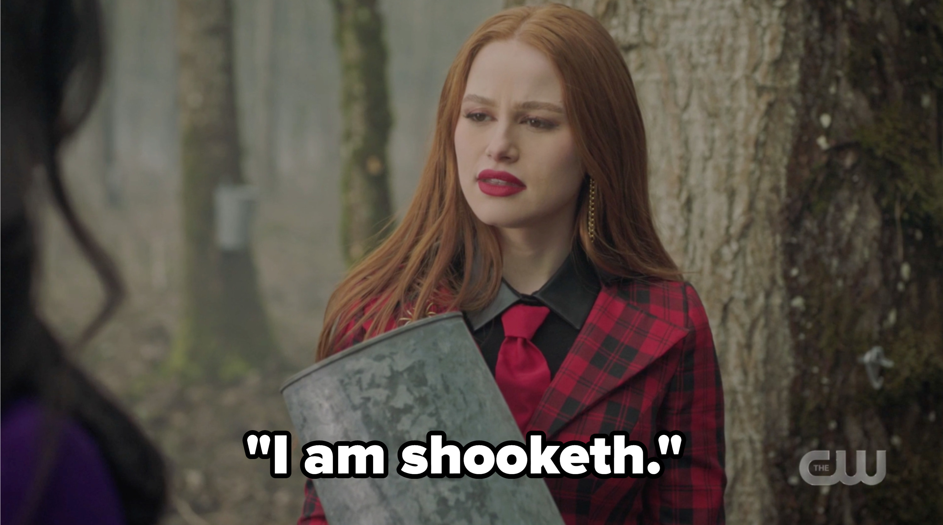 """Cheryl holding an empty maple syrup bucket and saying """"I am shooketh"""""""