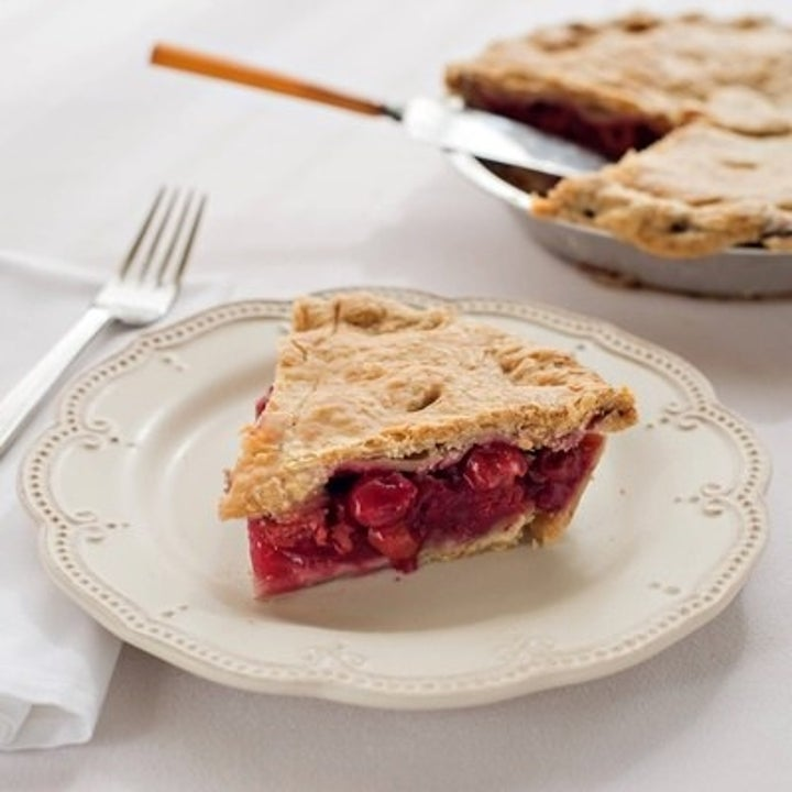 A slice of the old mission cherry pie next to the rest of the pie