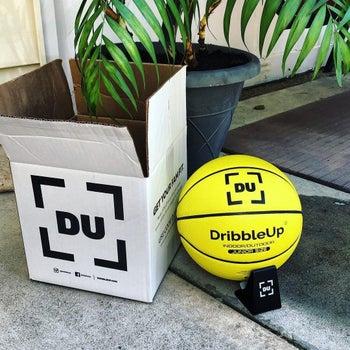 the yellow basketball next to white box