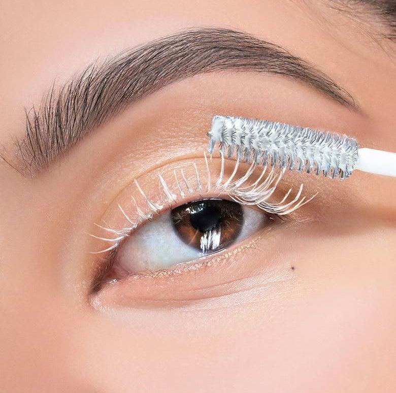 A model applies the white mascara primer