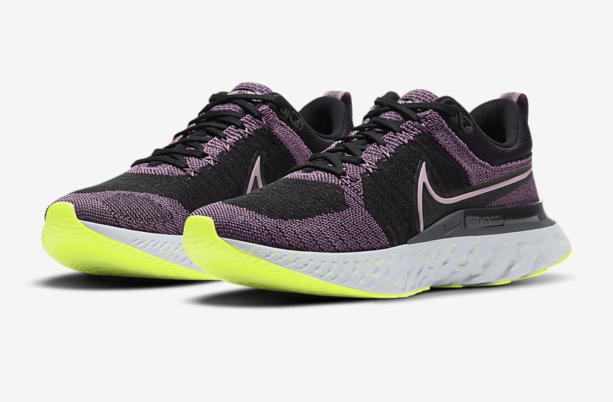 pink, black, and neon yellow Nike React Infinity Run Flyknit 2 sneakers