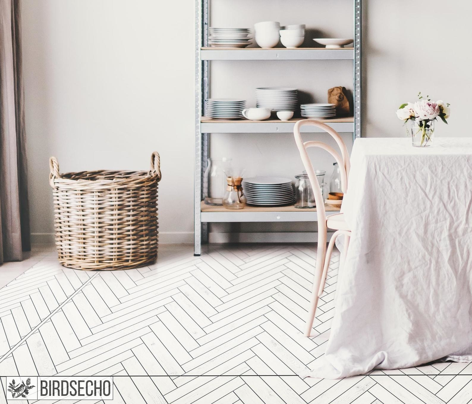 a large white herringbone vinyl mat in a naturally lit, white dining space