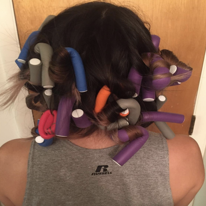 reviewer wearing the curling rods in their hair