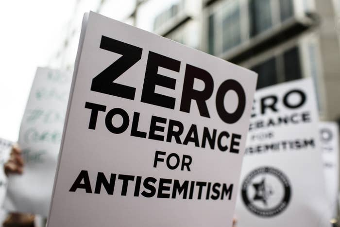 "A sign at a demonstration reads ""zero tolerance for antisemitism"""