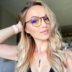 reviewer wearing the leopard frame glasses