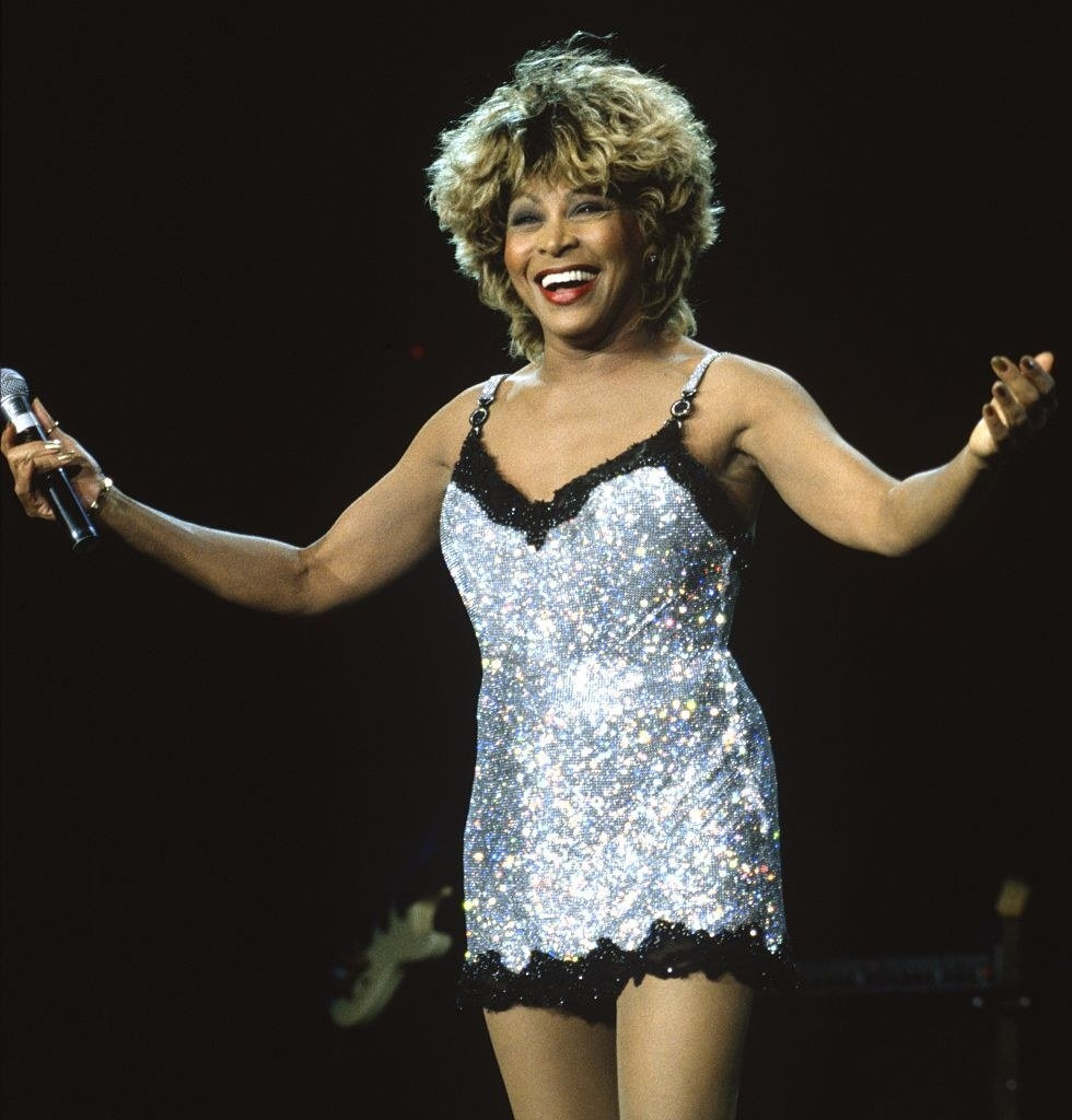 Tina Turner in a silver-and-black sequined slip dress