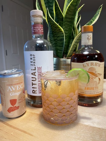 writer's can of ginger avec next to ritual whiskey alternative, lyre's amaretto alternative, and a cocktail garnished with a lime wheel
