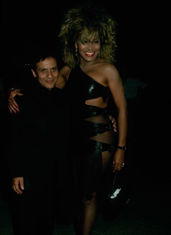 Tina Turner in a black leather cut-out dress