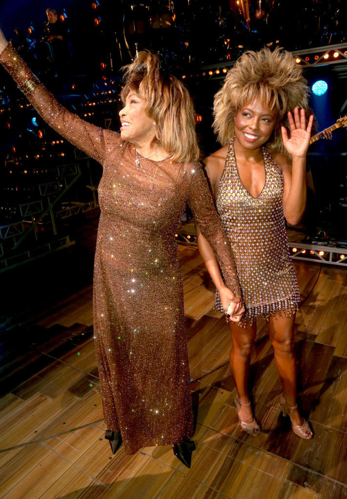 Tina Turner in a floor-length bejeweled tawny-brown gown