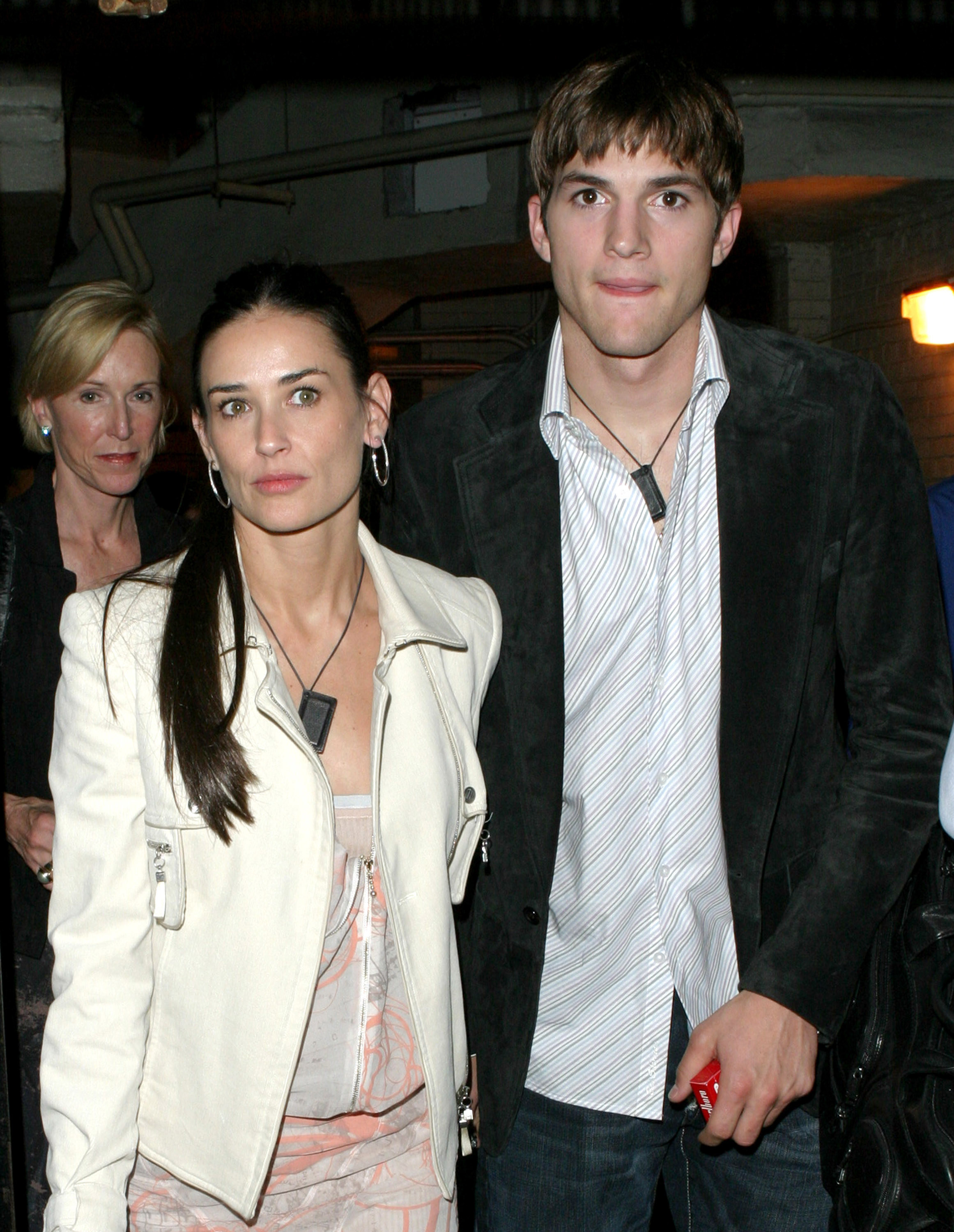 Demi Moore and Ashton Kutcher wear little leather books on necklaces