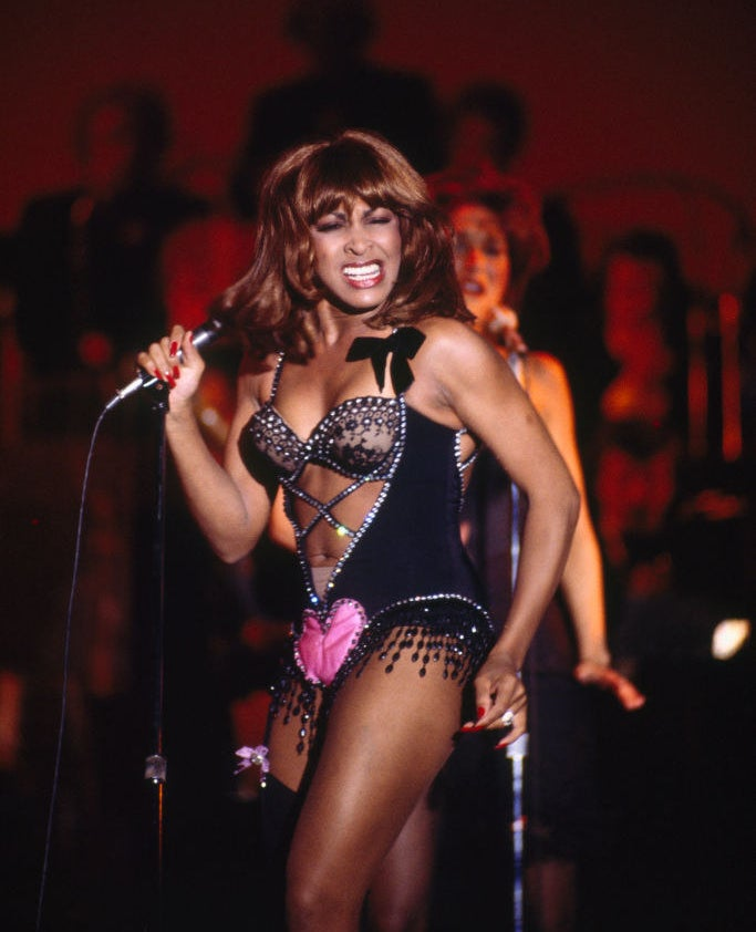 Tina Turner wearing a bejeweled bustier-corset
