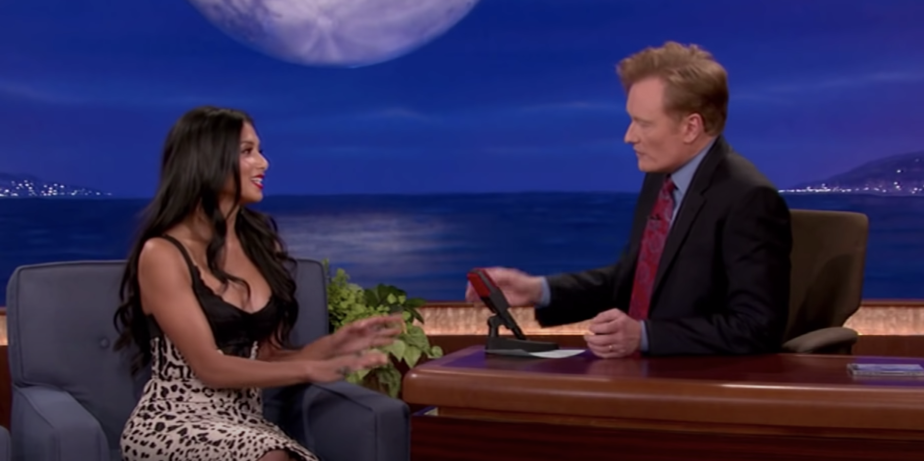 Conan O'Brien with a female guest on his talk show