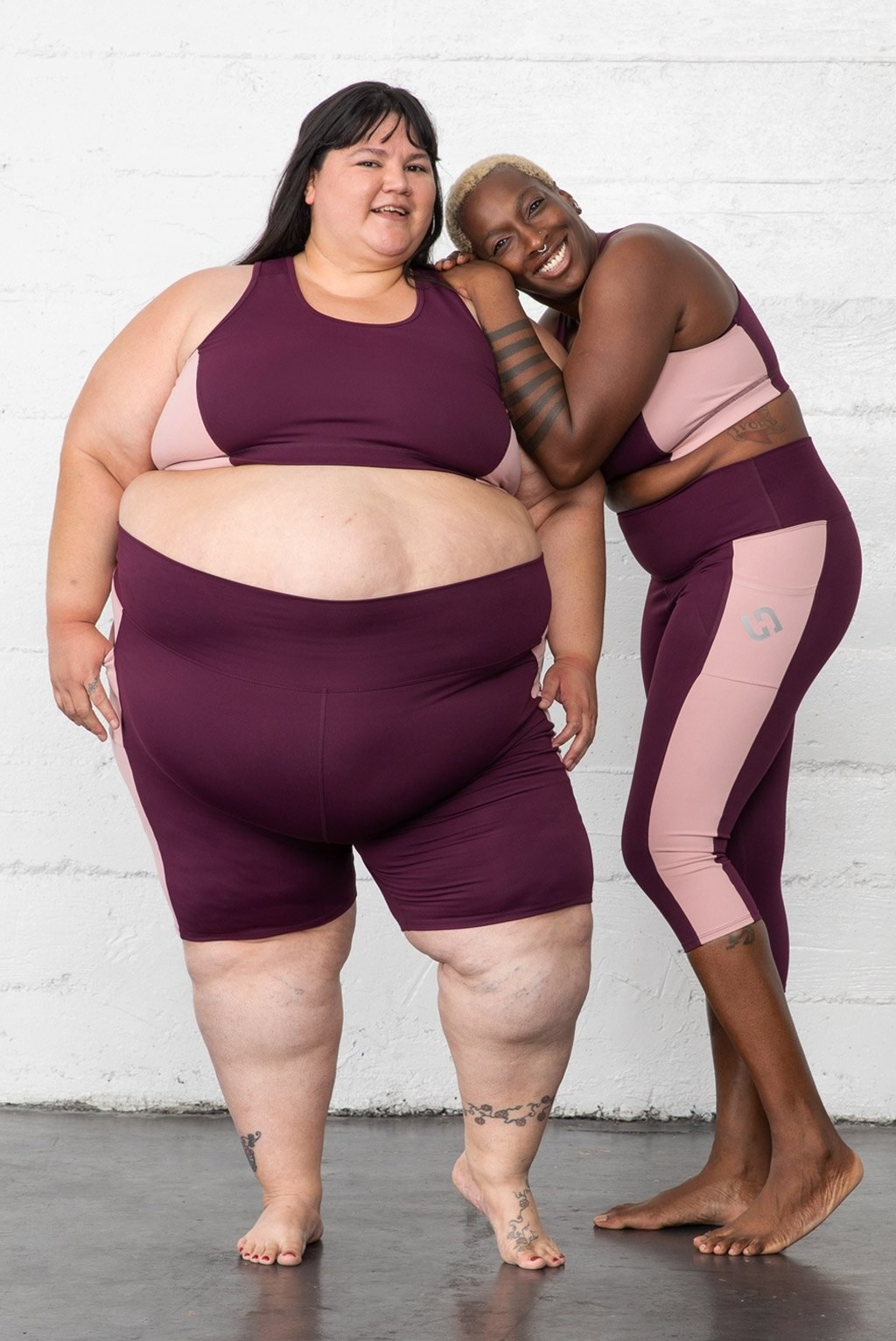 Models in a two tone pink and purple sports bra