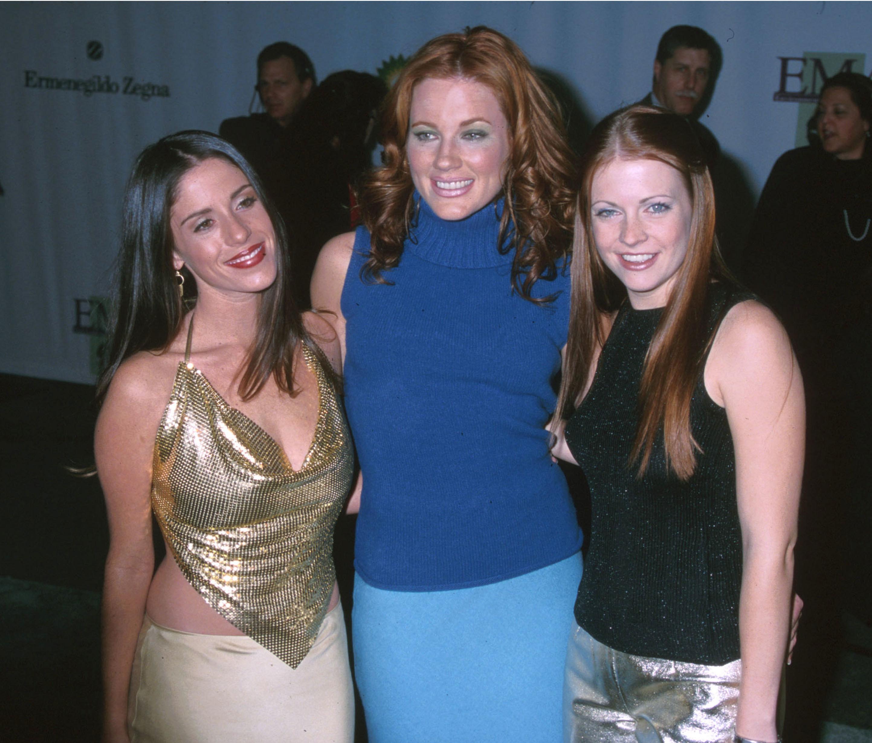 Soleil Moon Frye, Elisa Donovan, and Melissa Joan Hart in tank tops on the red carpet