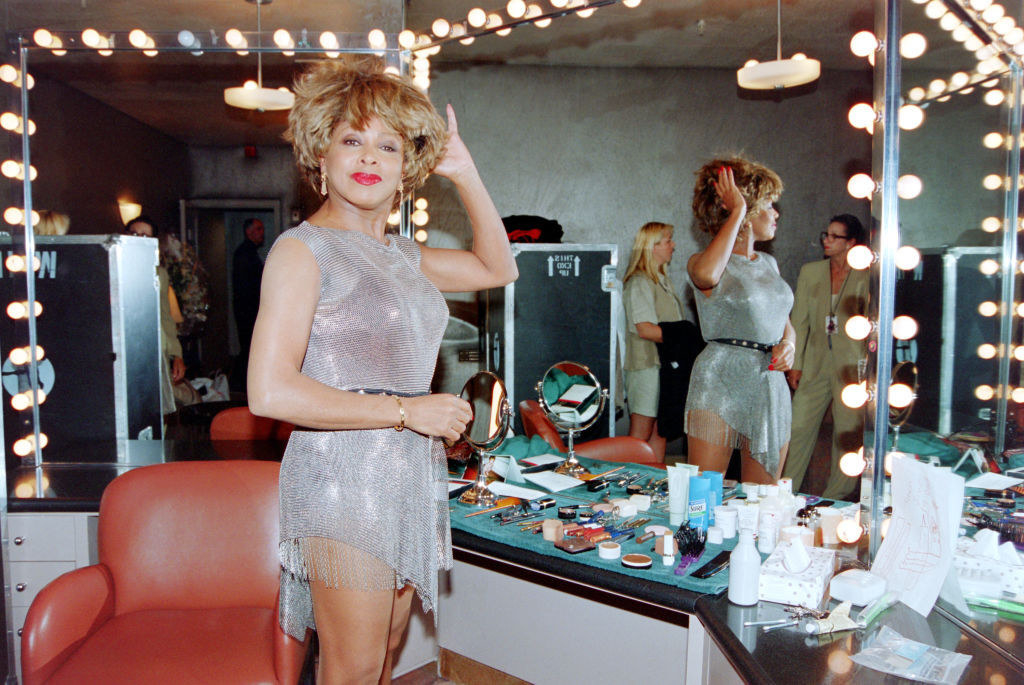 Tina Turner in a belted silver chain mail frock