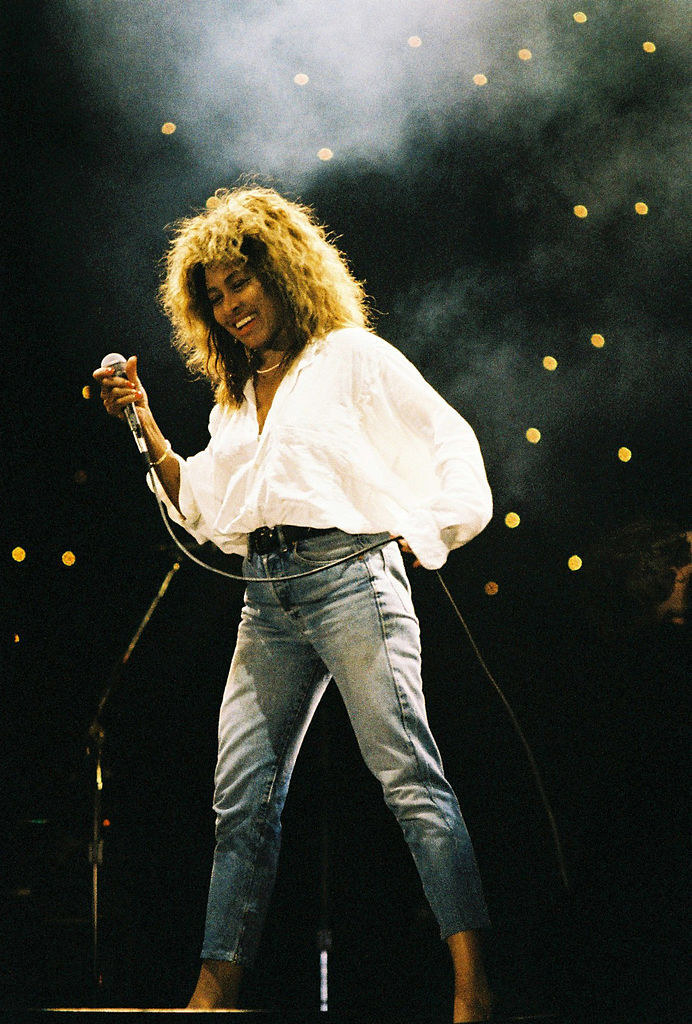 Tina Turner in faded jeans and a white button-down
