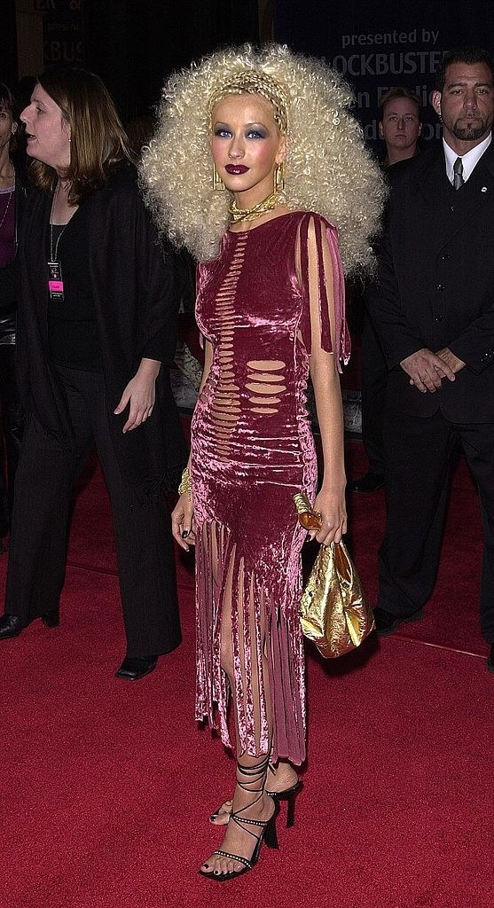Xtina in the infamous blonde afro and velvet dress at the Blockbuster Awards