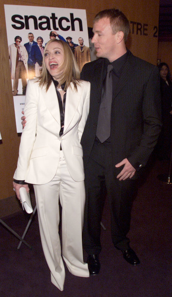 Madonna in a white with Guy Ritchie at the premiere of his film Snatch