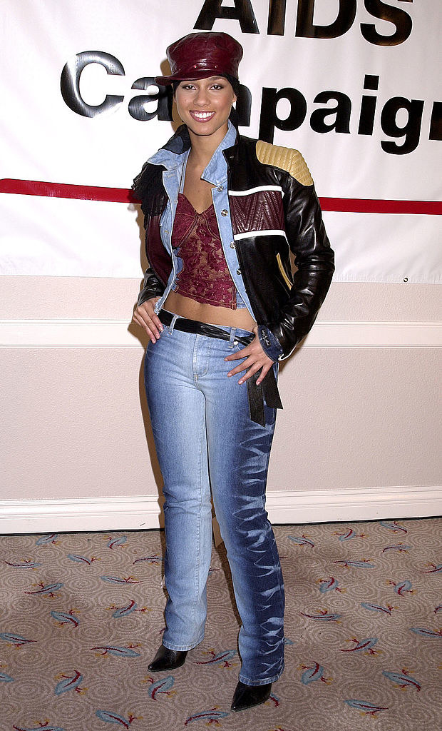 Alicia at an event wearing very faux distressed denim with a motorcylce jacket and leather cap