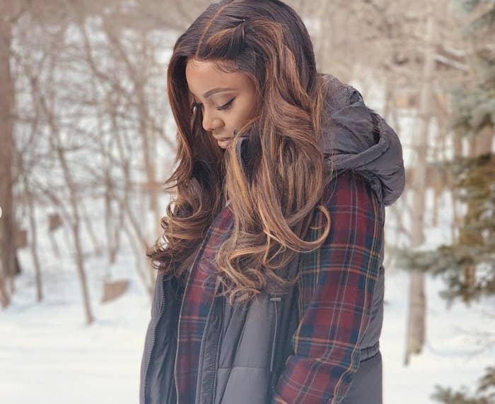 Theandra walking through the snow