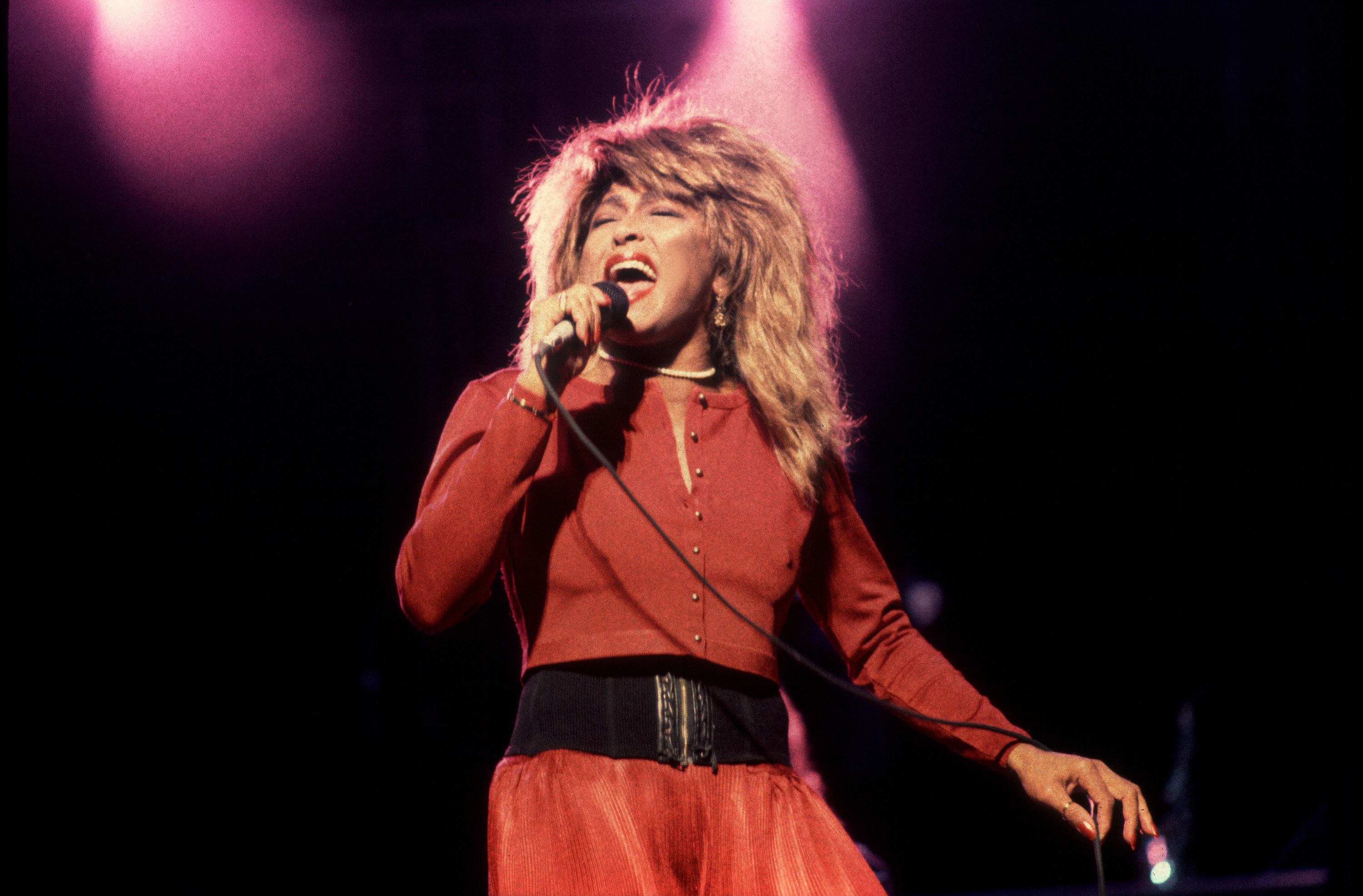 Tina Turner performing with microphone
