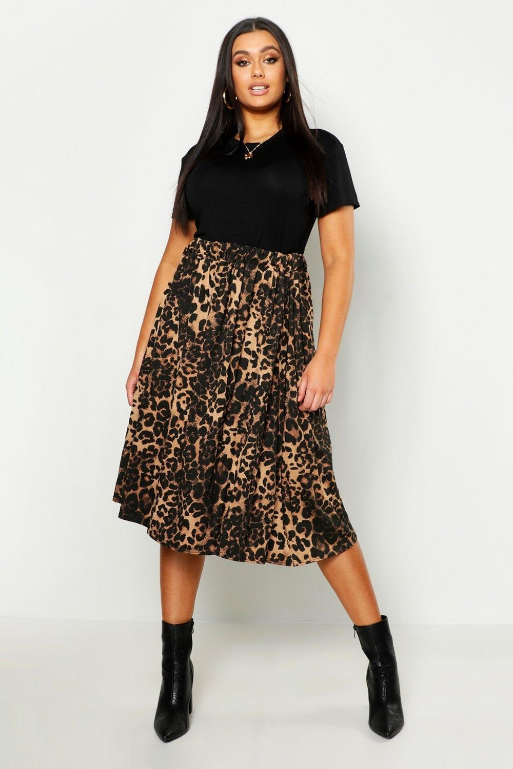 Model wearing the midi brown leopard print skirt